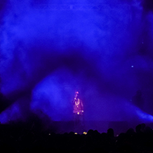 Blue lighting and smoke surrounding the opening act at Young Jeezy Concert at North Carolina A&T